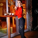 Beautiful Young Woman Poses Near Bright Cafe On The Street At Stock Photo Picture And Royalty Free Image Image 95148705