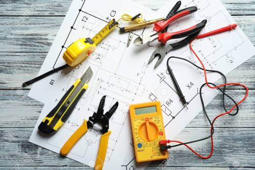 small resolution of different electrical tools and circuit diagram on wooden background wiring diagram explanation wiring diagram backgrounds