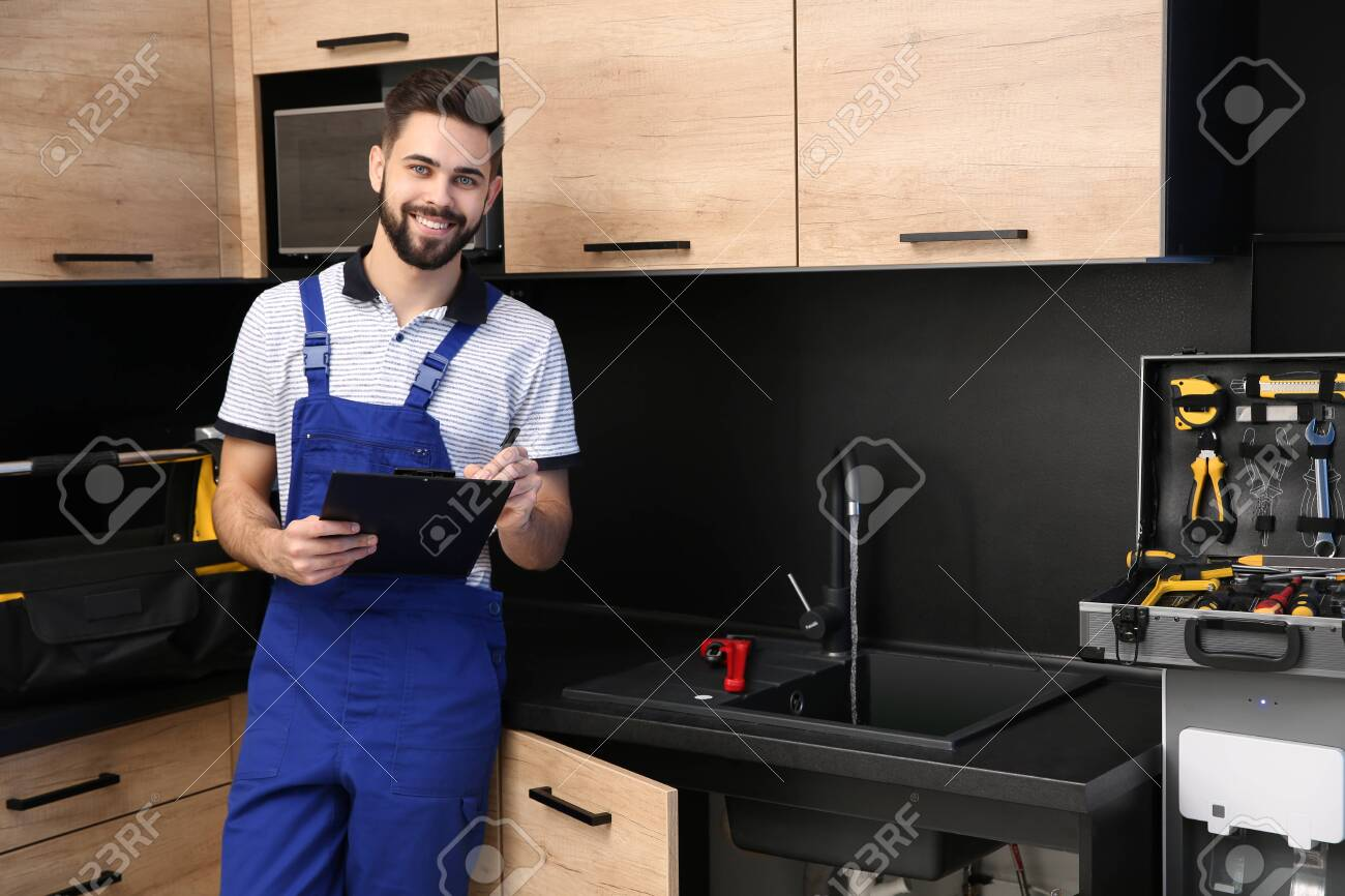 male plumber with clipboard near kitchen sink repair service stock photo picture and royalty free image image 124553643
