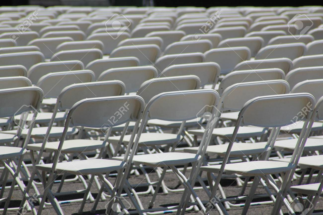 festival folding chair outdoor cushions sunbrella fabric rows of white empty chairs at a concert wedding or ceremony stock