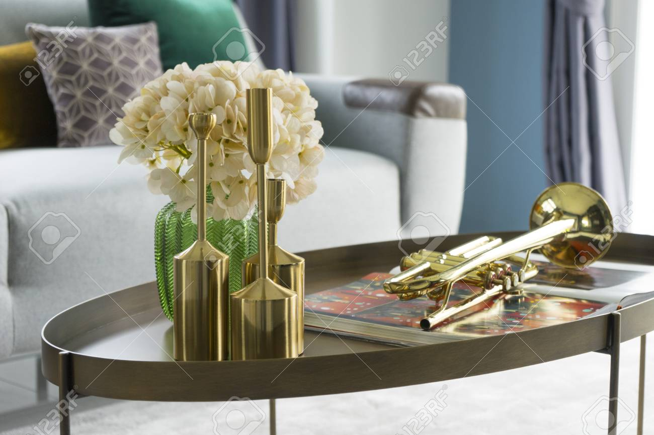 living room flower vases blue furniture sets colorful and stylish with vase gold trumpet on table stock photo