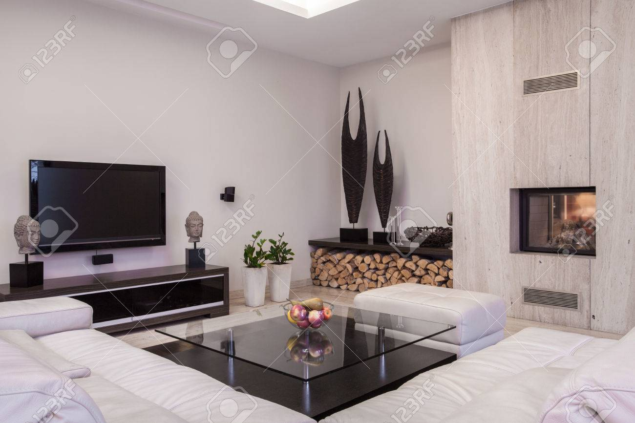 sitting room with plasma tv and fireplace
