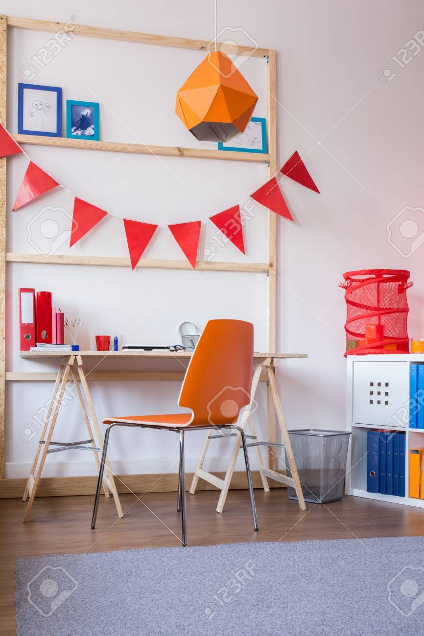 Teen Room Chair Wooden Desk And Orange Chair In Modern Teen Room