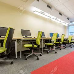 Swivel Chair On Carpet Blue Parson Covers Computer Room With Green Chairs And Fitted Stock Photo 57023762