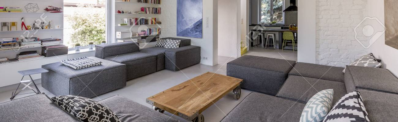 https www 123rf com photo 61114850 spacious living room with comfortable extra large couch and small wooden table panorama html