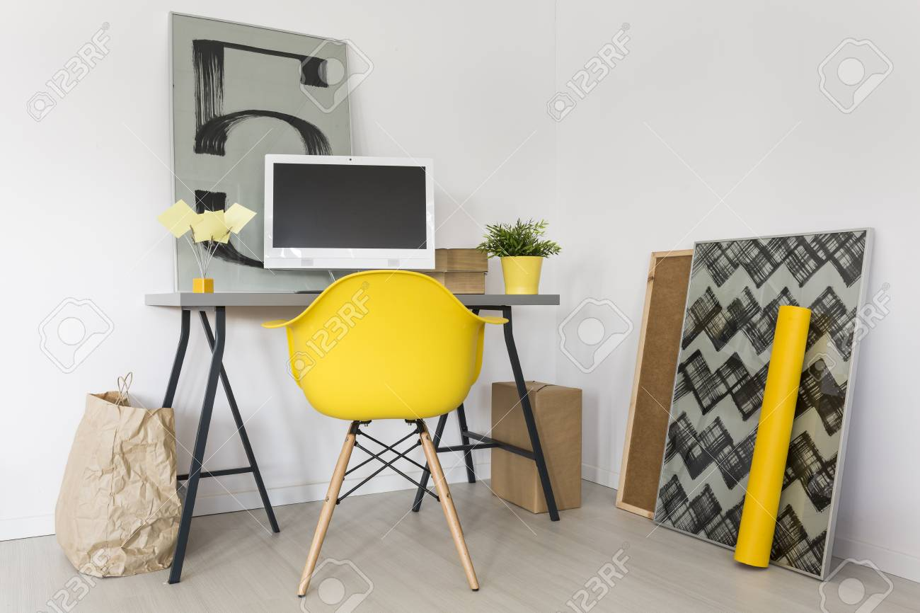 Minimalist Desk Chair Shot Of A Minimalist Workplace With Grey Desk And Yellow Office