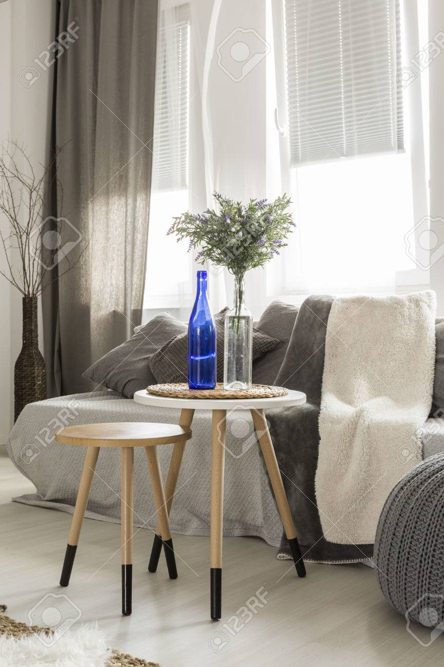 https www 123rf com photo 63816227 modern living room with sofa pouf new side tables window and stylish decorations html