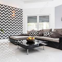 White Tile Floors In Living Room Macys Curtains For Posh With Tiled Floor And Black Lounge Set Stock Photo 76938163