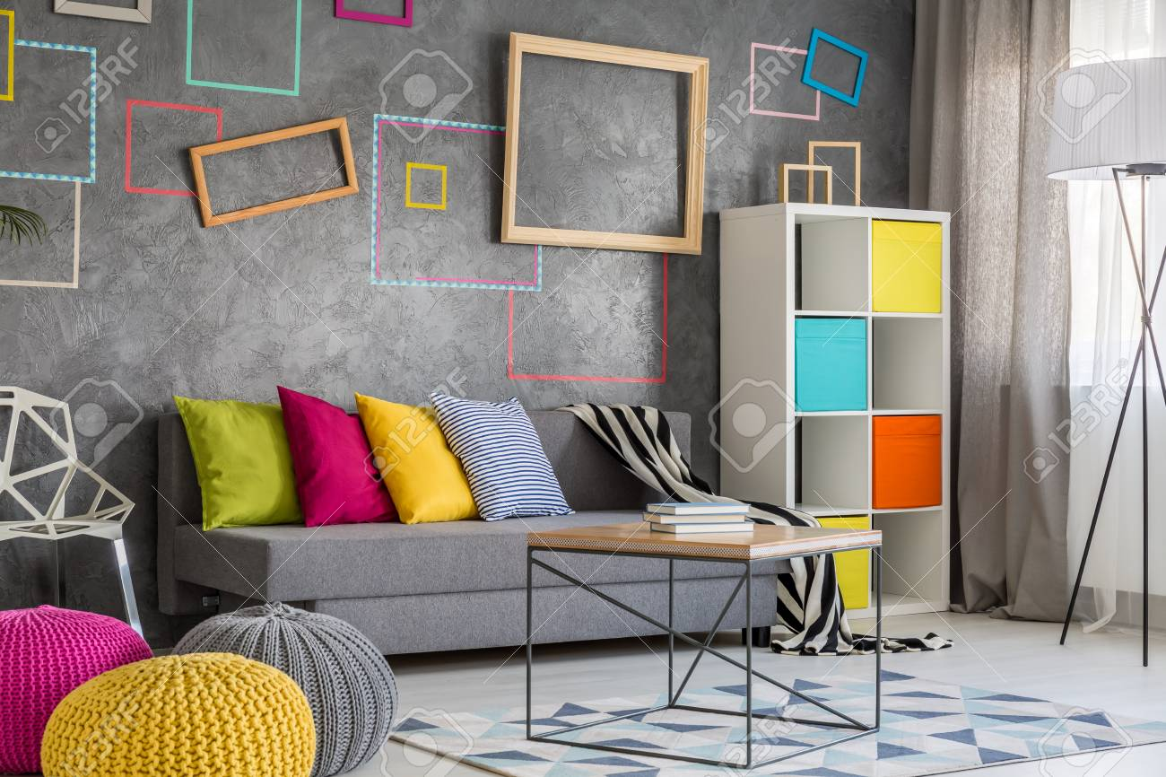wall frames for living room narrow ideas with fireplace new flat grey sofa colorful pillows and stock photo 78530225