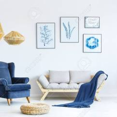 Living Room Arm Chair Orange Sets White And Blue With Sofa Armchair Lamp Posters Stock Photo