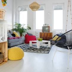 Living Room Pouf Blue And White Decor With Round Chair Yellow Sofa Pallet Furniture Stock Photo