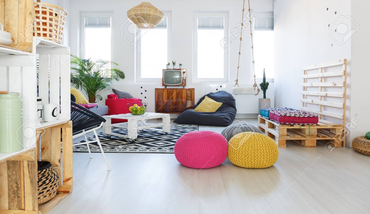 pouf in living room gray and purple ideas colorful retro with tv swing crate furniture stock photo