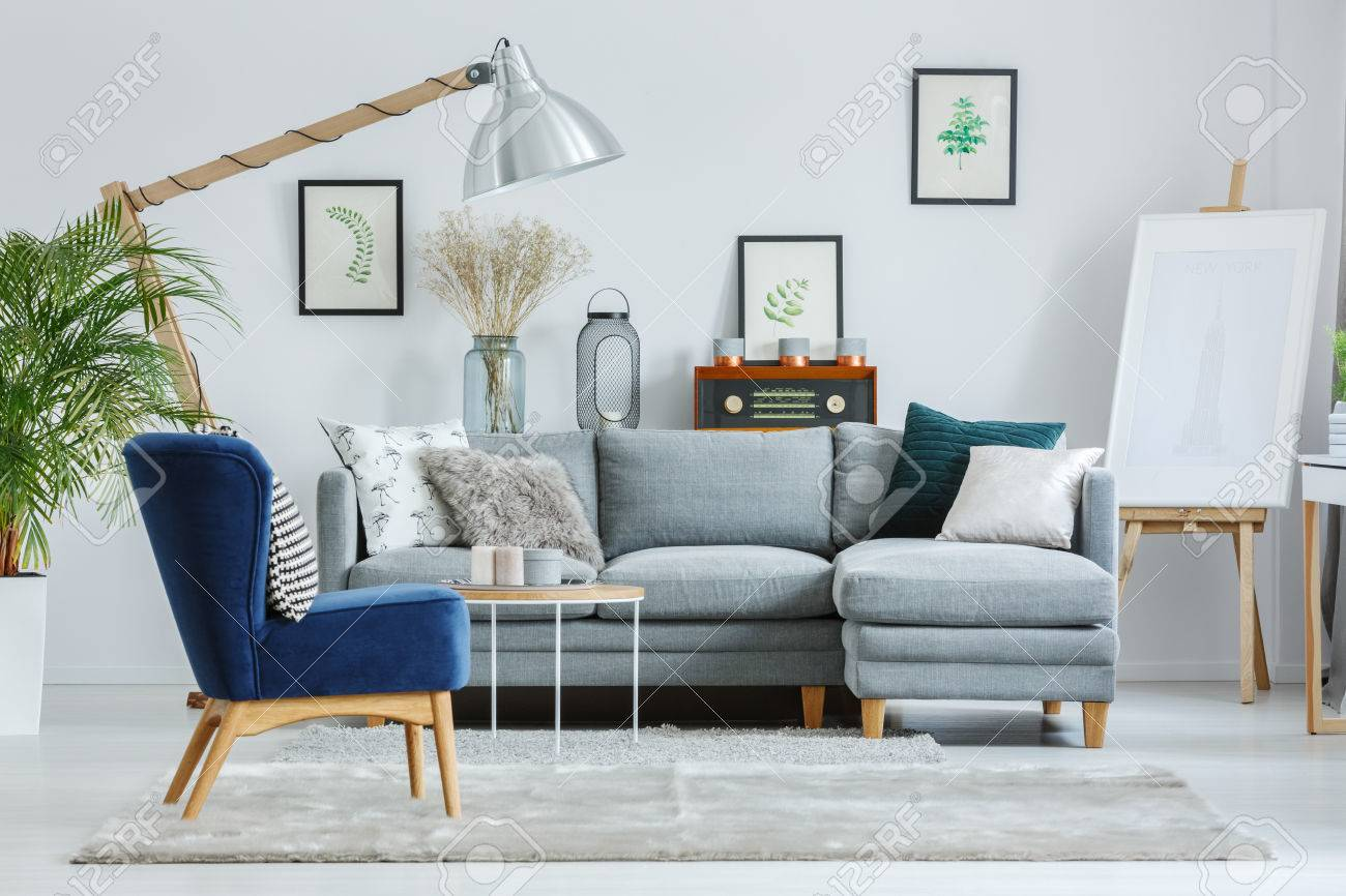 grey sofa living room carpet ideas for a large wall blue armchair on in designer s with lamp easel and