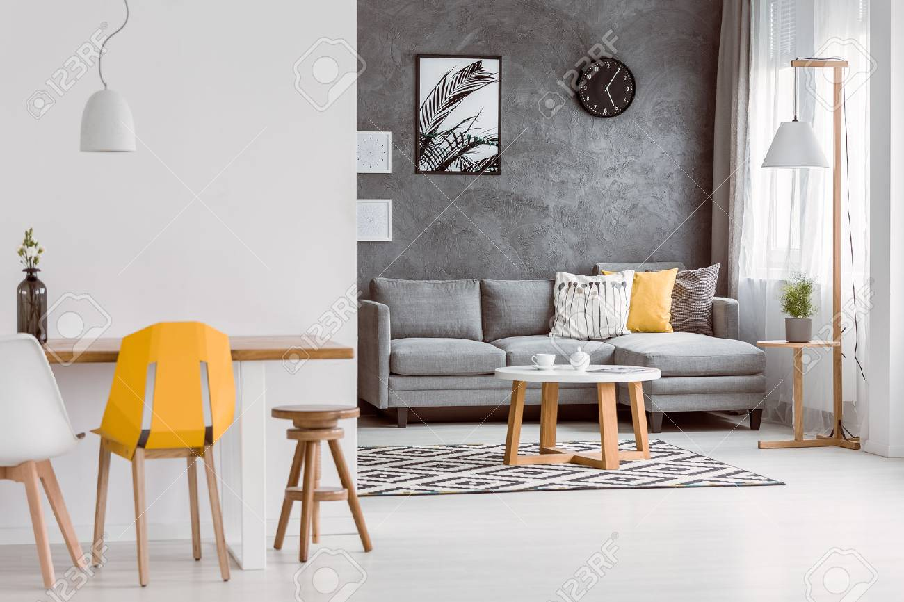 Grey And Yellow Chair Yellow Chair At Wooden Table In Modern Living Room With Decorative