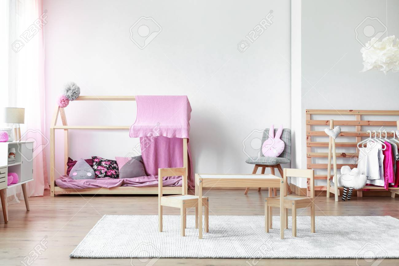 bedroom chair for clothes farm style chairs small wooden table and on white carpet in girls with handmade hanger