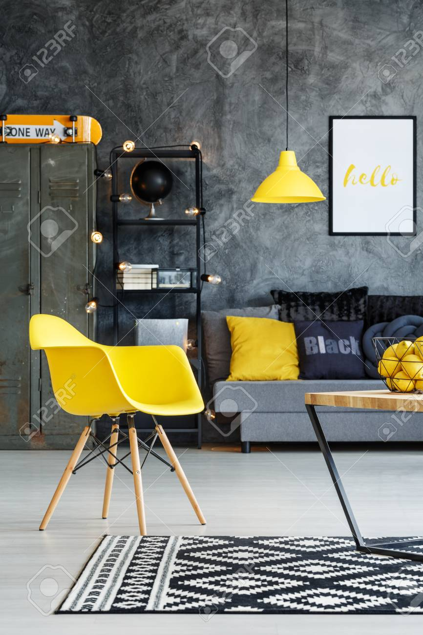 Grey And Yellow Chair Yellow Chair In Teenager S Living Room With Grey Sofa And Orange