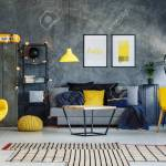 Blue Blanket In Contemporary Living Room With Yellow Pillow On