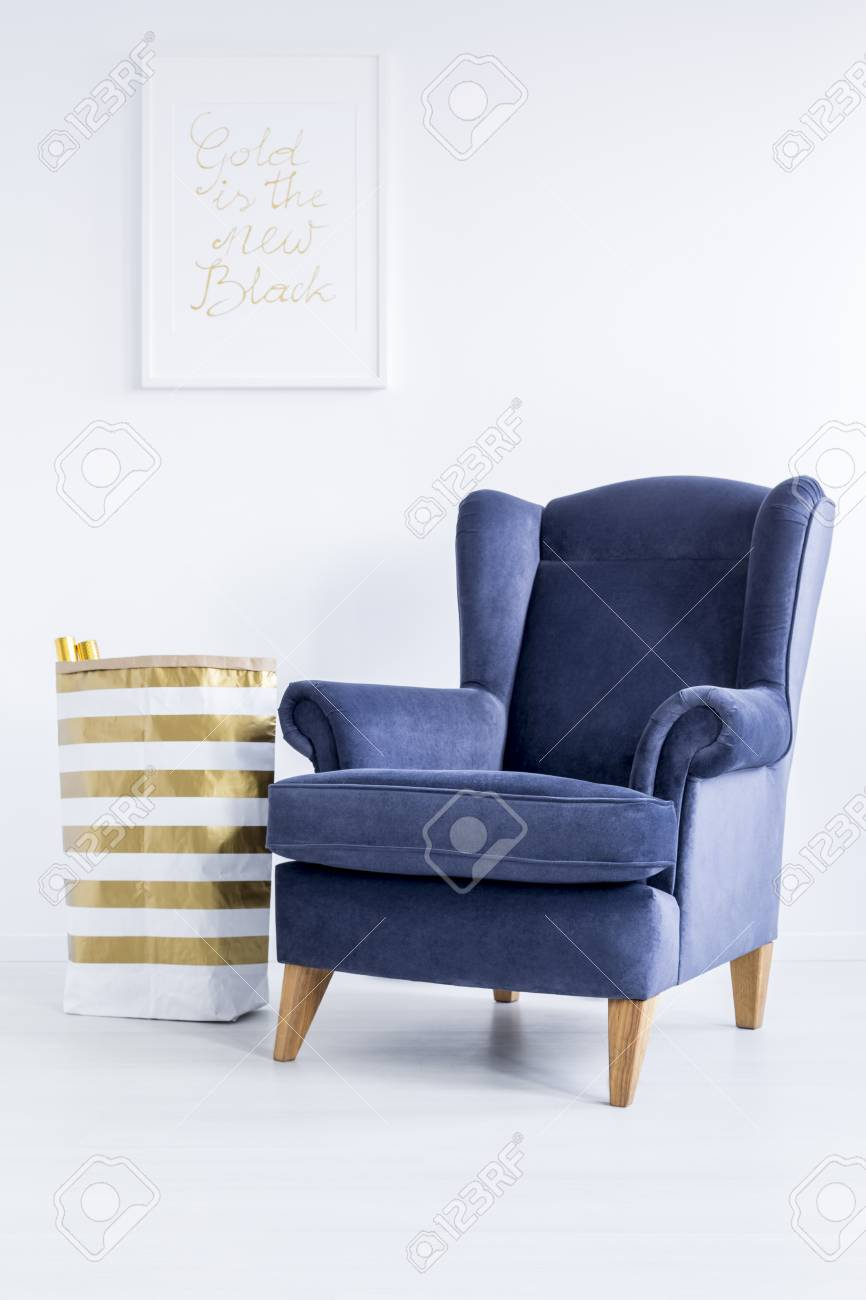 Blue And White Striped Chair Striped Material Basket Standing Next To Dark Blue Armchair In