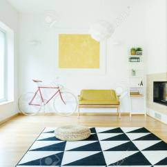 Pouf In Living Room Grey Settee Ideas On Triangle Carpet Bright With Fireplace Stock Yellow Sofa And Red Bike Against