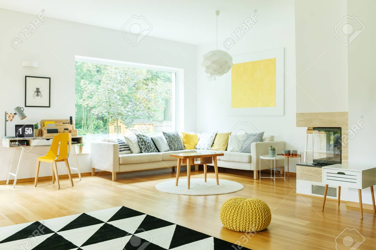 pouf in living room outdoor designs wooden table on white round carpet with yellow stock photo floor and gold painting wall