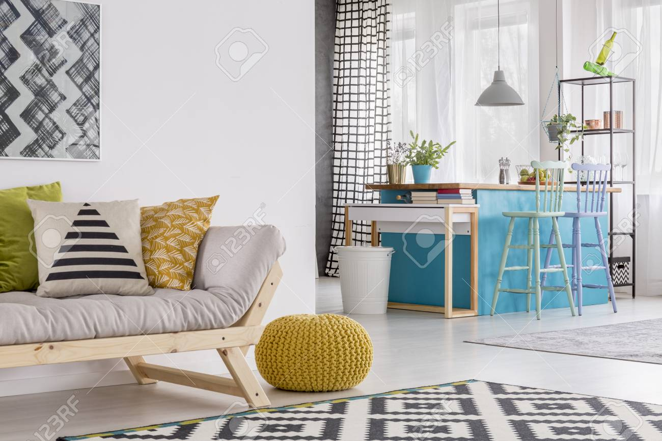 living room pouf michael amini sets pillows on grey sofa and yellow in spacious stock with stools at blue table