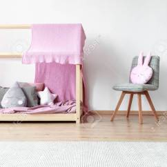 Bedroom Chair With Blanket Burlap Covers Wedding Pink Pillow On Grey Next To Wooden Bed In Bright Baby S