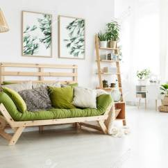 Cushions Living Room Decor Ideas India Green Wooden Sofa With Many Standing In Bright Interior Botanic Posters Stock