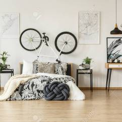 White Wooden Chair For Desk Black Leather Recliner Against In Trendy And Bedroom Stock Photo Teenager With Bike Plants Patterned Decorations