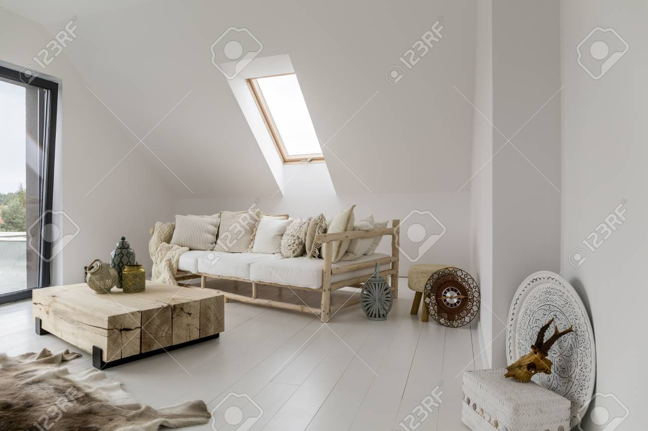 living room vase decoration leather furniture decorative lantern and on wooden table between beige sofa fur floor in rustic