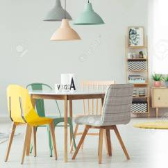 Yellow And Grey Chair Office Ballet Peach Mint Lamp Above Round Table Stock In Dining Room Interior