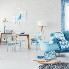Sofa Rocking Chair Antique Chippendale Camelback Blue Next To With Patterned Blanket In Spacious Living Room Interior Plants