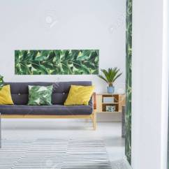 Cushions Living Room Design 2018 Philippines Yellow On Black Settee In Modern Interior Stock Photo With Green Leaves Poster White Wall And Plant Wooden Cupboard