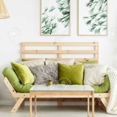 Green Cushions Living Room Lights For Wall Close Up Of Wooden Sofa With Standing Against Stock A White Leaves