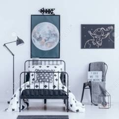 Bedroom Chair With Blanket Ergonomic Justification And Bed Against White Wall Moon Astronaut Poster In Interior