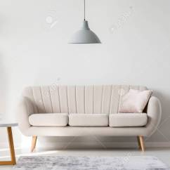 Bright Sofa Single Size Sleeper With Decorative Silver Pillow Standing In Living Room Interior Empty Wall Stock