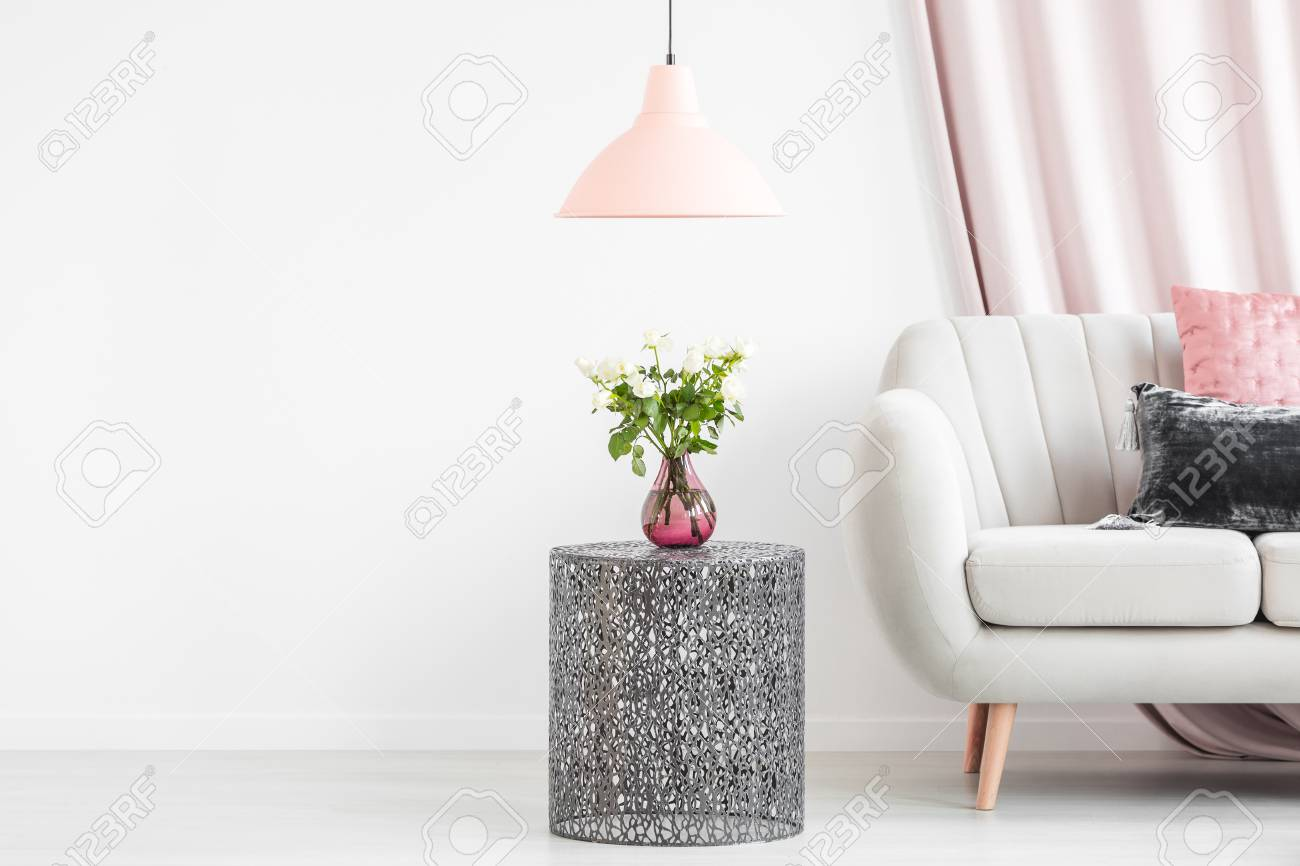 Metal Side Table With Bouquet In A Vase Next To A White Sofa Stock Photo Picture And Royalty Free Image Image 96924623