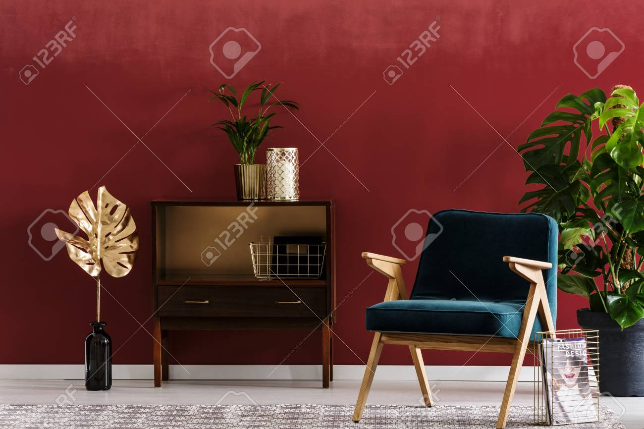 Red Living Room Chair Green Wooden Armchair Next To A Cabinet And Vase With Gold Leaf