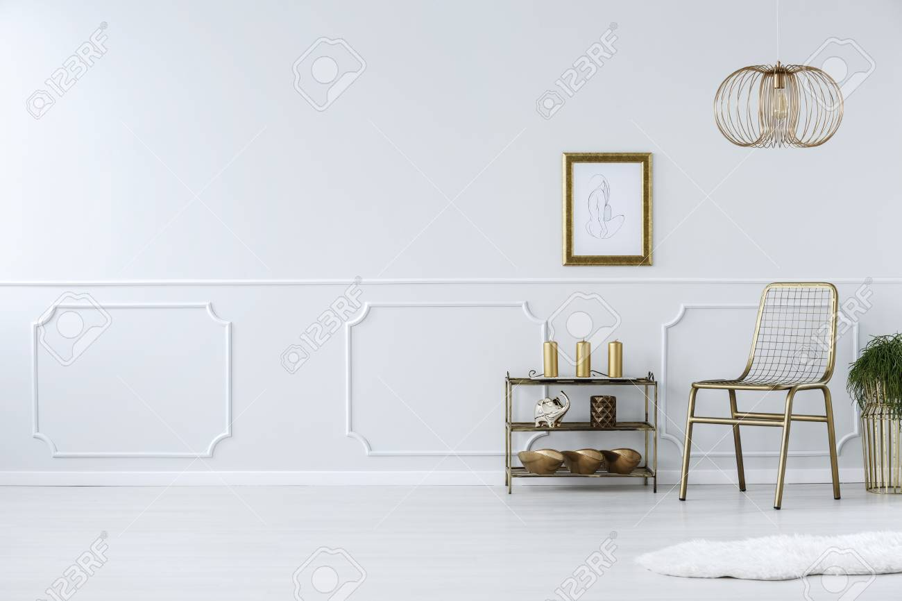 white and gold chair walmart butterfly against wall with molding in living room interior poster copy space