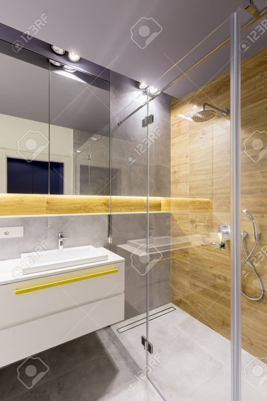modern bathroom interior with glass shower cabin dark gray tiles stock photo picture and royalty free image image 100063539