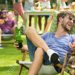 Folding Chair Jokes Cover Hire Cambridgeshire Boy And Girl Laughing Telling During Grill Party Stock Photo 100728952