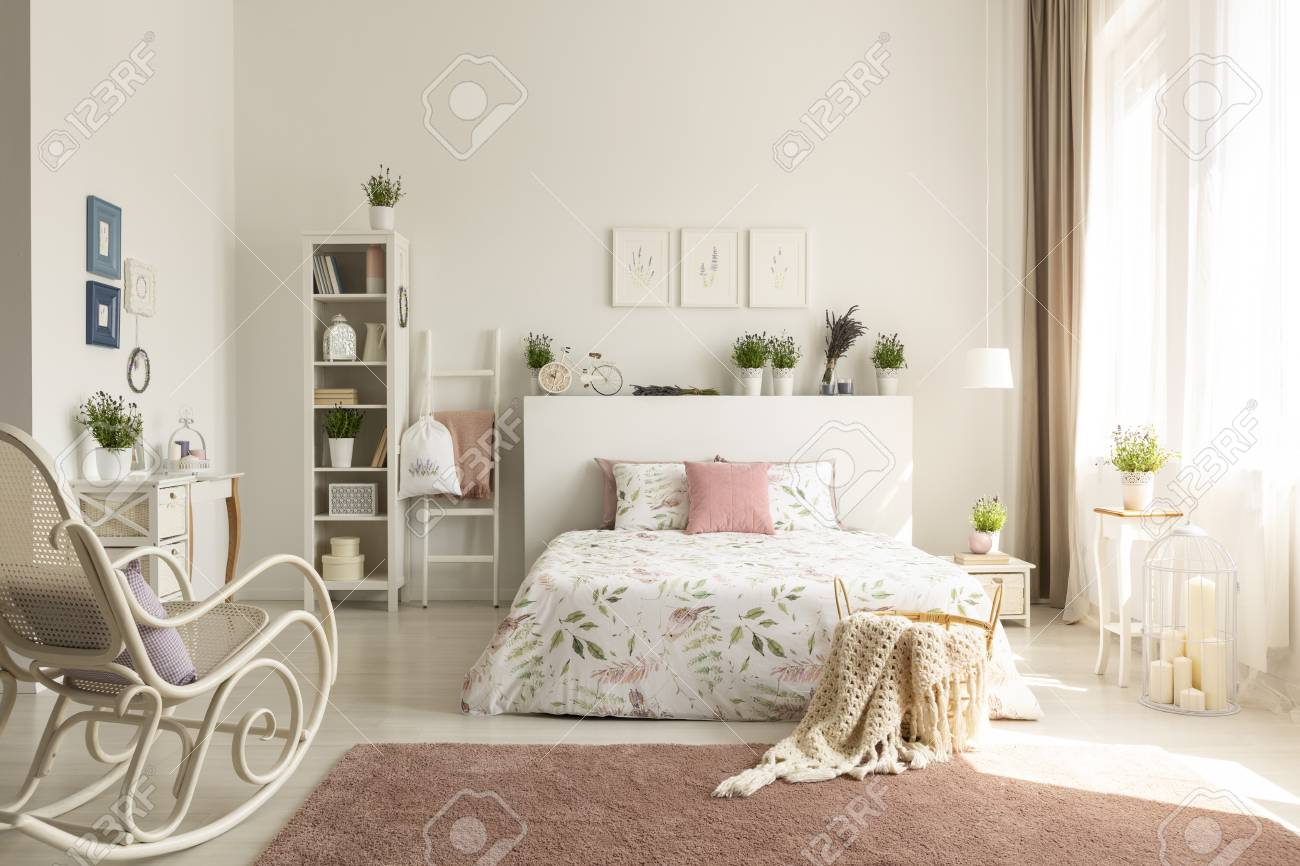 bedroom rocking chair pottery barn dining slipcovers white interior with dirty pink carpet stock photo window drapes and king size bed in the real