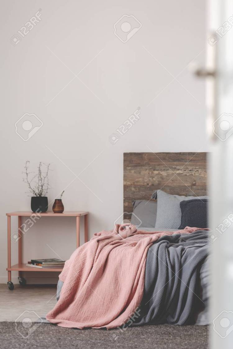 Grey And Pink Bedroom Design With Copy Space On Empty White Wall Stock Photo Picture And Royalty Free Image Image 113915958
