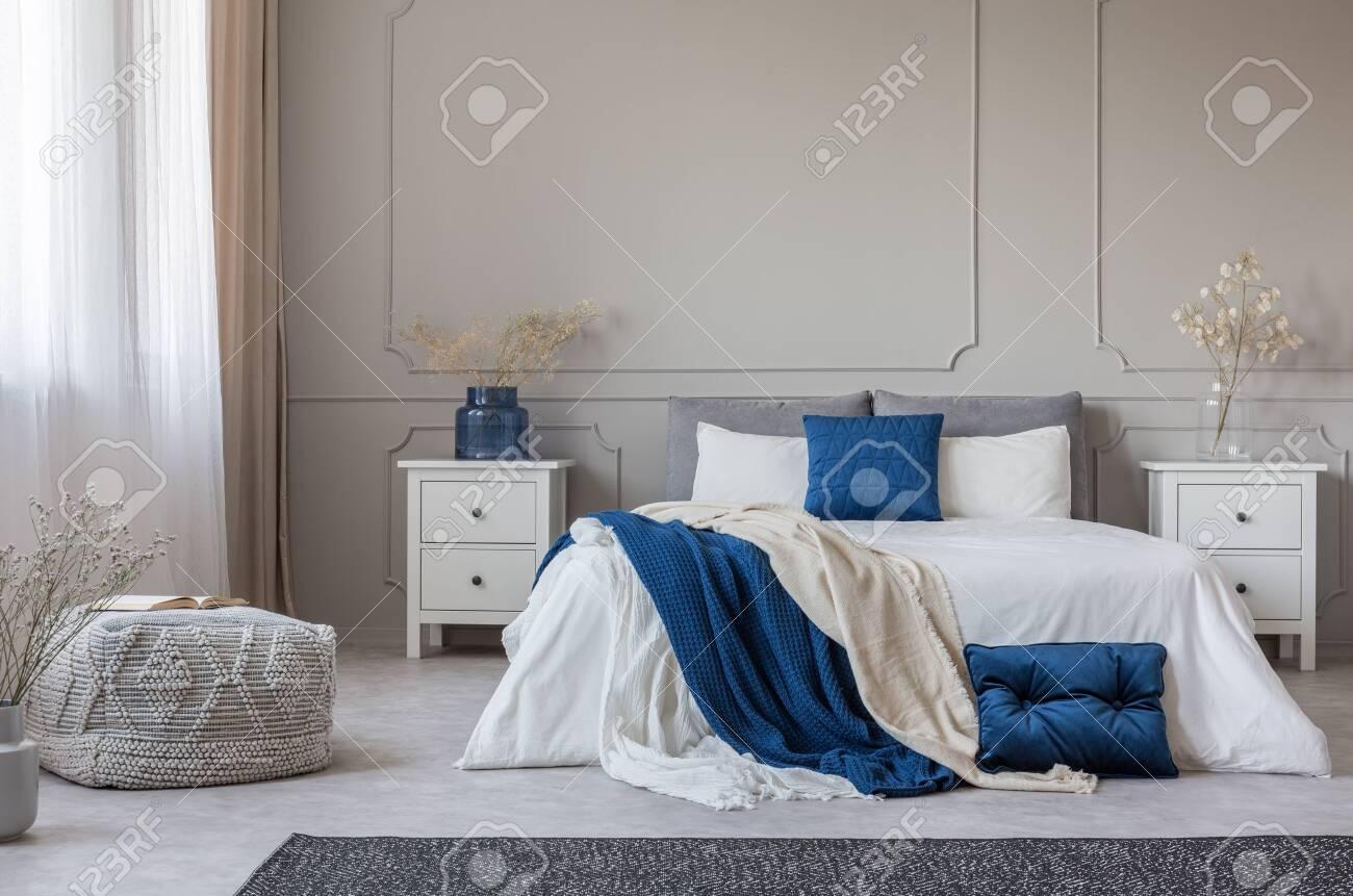 blue pillow and blanket on white bed in spacious bedroom interior stock photo picture and royalty free image image 128922298