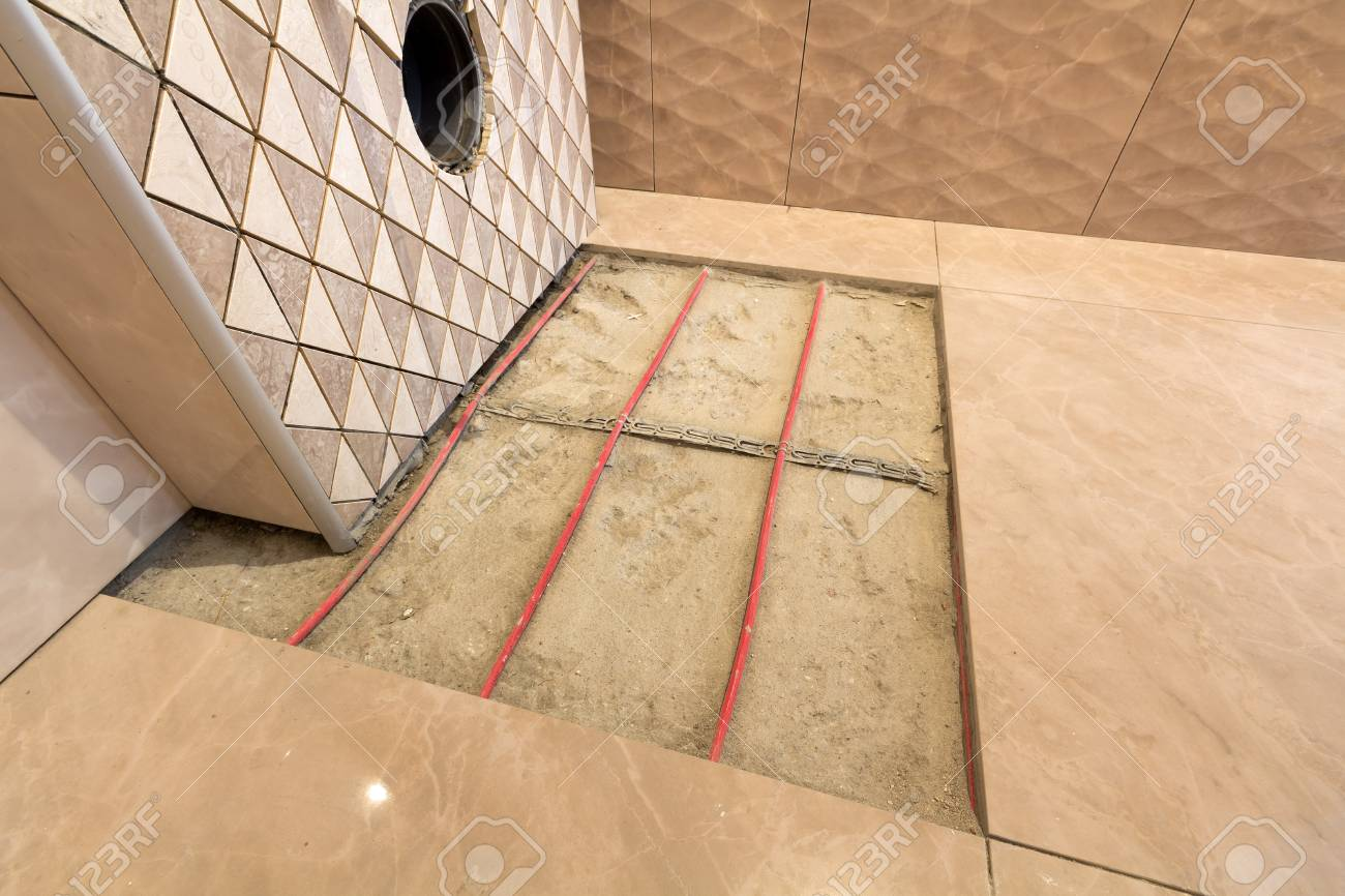 unfinished reconstruction of bathroom with ceramic tiles installed