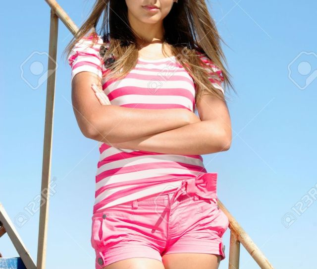 Stock Photo Young Beauty On The Ladder Over Sky