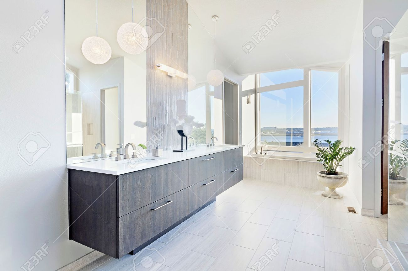 beautiful master bathroom in new luxury home with double vanity
