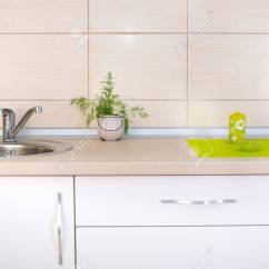 Kitchen Candles Wolf Wooden Countertop With Decorative Mat And Herb Stock Photo Against Wall Beige Tiles