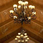 Wrought Iron Chandeliers Hanging From A Wood Beam Ceiling Stock Photo Picture And Royalty Free Image Image 120964324