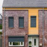 Modern Dutch Terrace House Decorated With Plants Behind The Windows