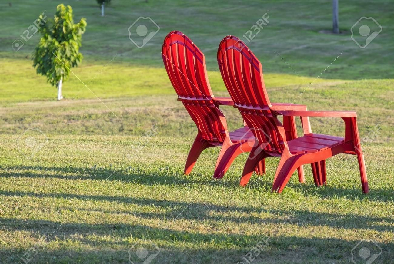 Red Adirondack Chairs Two Red Adirondack Chairs On The Lawn